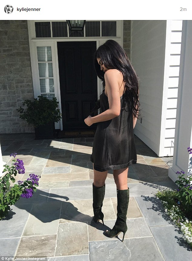 Fancy:That same day she shared a photo where she was wearing a black sleeveless dress and black heeled boots while outside her new mansion