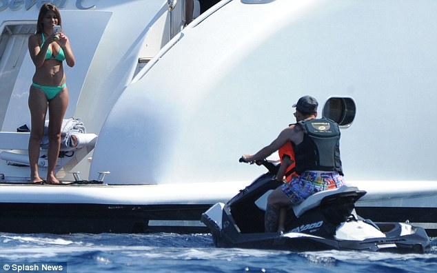 And it seems Lionel's eldest son is a bit of a thrill-seeker, as the adorable lad was seen being helped into a large orange life jacket by his dutiful mother before he hopped onto a jet ski with his father