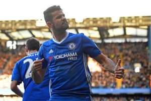 Chelsea's Brazilian-born Spanish striker Diego Costa celebrates after scoring the opening goal of the English Premier League football match between Chelsea and West Bromwich Albion at Stamford Bridge in London on December 11, 2016. / AFP / Justin TALLIS / RESTRICTED TO EDITORIAL USE. No use with unauthorized audio, video, data, fixture lists, club/league logos or 'live' services. Online in-match use limited to 75 images, no video emulation. No use in betting, games or single club/league/player publications.  /         (Photo credit should read JUSTIN TALLIS/AFP/Getty Images)
